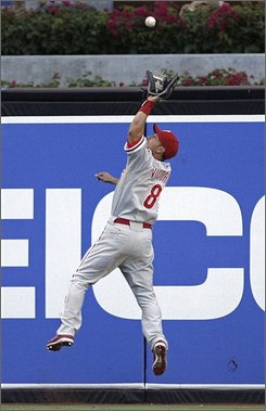 In this Aug. 17, 2008 file photo, Philadelphia Phillies center fielder Shane Victorino makes a leaping catch of a ball hit by San Diego Padres' Kevin Kouzmanoff in the fourth inning of a baseball game in San Diego. Victorino of the World Series champion Philadelphia Phillies was among five first-time Gold Glove winners in the National League Wednesday Nov. 5, 2008. (AP Photo/Lenny Ignelzi, File)