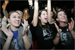 Leslie Rogers, from Georgia, from left, Mina Bishop, from Florida, and Melina Baetti, from Georgia, react at the announcement of the victory of President-elect Barack Obama Wednesday, Nov. 5, 2008, in Paris. (AP Photo/Thibault Camus)