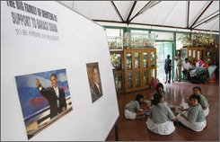 Indonesian students sit on the floor near posters of U.S. Presidential candidate Barrack Obama at SDN Menteng 1, which is the school Obama attended when he lived in Indonesia with his mother, in Jakarta Tuesday, Nov 4, 2008. Forty years after Obama said in his third grade class that his dream was to become president, his teacher, Sri Murtiningsi, like the rest of the world, is watching closely as Americans prepare to head to the polls Tuesday in what could be the most pivotal election in history. (AP Photo/Achmad Ibrahim)