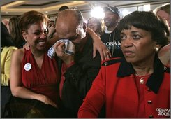 Dr. Roy Heron, center, sheds a tear as his wife, Barbara, left and Sandra Stiner-Lowe, right, celebrate during a victory party  in McLean, Va., Tuesday, Nov. 4, 2008.  (AP Photo/Steve Helber)