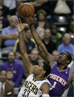 Indiana Pacers forward Danny Granger (33) has his shot blocked by Phoenix Suns center Amare Stoudemire (1) during the first quarter of an NBA basketball game in Indianapolis, Wednesday, Nov. 5, 2008. (AP Photo/Darron Cummings)