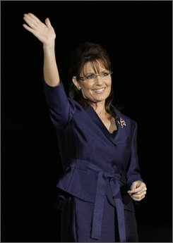 Gov. Sarah Palin, R-Alaska, acknowledges the crowd during an election night rally in Phoenix Tuesday, Nov. 4, 2008. (AP Photo/Elise Amendola)