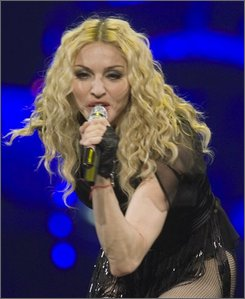 In this Oct. 22, 2008 file photo, pop star Madonna performs during her Sticky and Sweet tour in Montreal. (AP Photo/The Canadian Press, Ryan Remiorz)