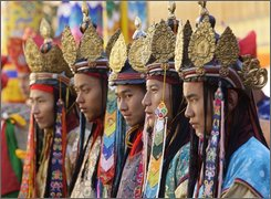 Traditionally attired Bhutanese dancers look on during a coronation ceremony at the Tashichho Dzong in Thimpu, Bhutan, Thursday, Nov. 6, 2008.T he tiny Himalayan nation of Bhutan crowned it's 5th king Thursday after a two-year wait for the precise moment deemed most auspicious for a successful reign by court astrologers. (AP Photo/Gurinder Osan)