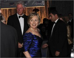Sen. Hillary Rodham Clinton D-N.Y. and husband, former President Bill Clinton, who sat at different tables, are briefly seen together at the 17th Annual Salute to Freedom Gala on the Intrepid Sea Air and Space Museum, Thursday, Nov. 6, 2008, in New York. (AP Photo/Louis Lanzano)