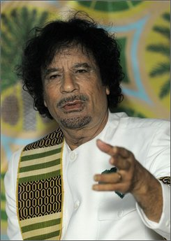  Libyan leader Moammar Gadhafi speaks to the press  in Kiev, Ukraine, Thursday, Nov. 6, 2008. Gadhafi finished his trip to Ukraine, Belarus and Russia on Thursday which appears aimed at spurring competition between the countries for the best terms on arms and trade deals while seeking to rekindle the Cold War ties his energy-rich nation had with the Soviet Union (AP Photo/Sergei Chuzavkov)