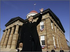 In this Feb. 10, 2007 file photo, then Sen. Barack Obama, D-Ill., waves to spectators as he arrives to announce his candidacy for president of the United States at the Old State Capitol in Springfield, Ill. (AP Photo/Charles Rex Arbogast, File)