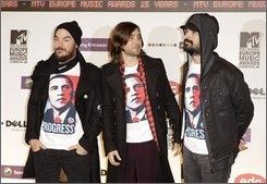 From left, Shannon Leto, Jared Leto and Tomo Milicevic, members of the U.S. band 30 Seconds to Mars arrive at the 2008 European MTV Awards in Liverpool, England, Thursday, Nov. 6, 2008. (AP Photo/Joel Ryan)