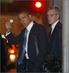  President-elect Obama is accompanied by foreign policy adviser Denis McDonough as he leaves a meeting in Chicago, Thursday, Nov. 6, 2008. (AP Photo/Charles Dharapak)
