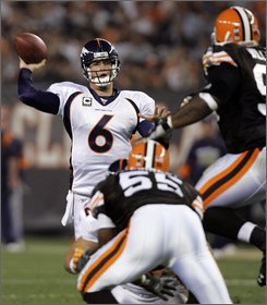 Denver Broncos quarterback Jay Cutler (6) throws a pass against the Cleveland Browns in the second quarter of an NFL football game Thursday, Nov. 6, 2008, in Cleveland. (AP Photo/Mark Duncan)