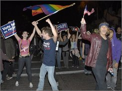  Protesters march down Santa Monica Boulevard in West Hollywood, Calif., Wednesday, Nov. 5, 2008 during a &quot;No on Prop 8&quot; rally. In a heartbreaking defeat for the gay-rights movement, California voters put a stop to gay marriage, creating uncertainty about the legal status of 18,000 same-sex couples who tied the knot during a four-month window of opportunity opened by the state's highest court. (AP Photo/Dan Steinberg)