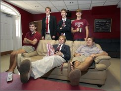  Members of the Lambda Sigma Phi fraternity lounge in their den and watch football prior to the Ole Miss-Alabama football game at their fraternity house in Tuscaloosa, Ala., Saturday, Oct. 18, 2008. Lambda Sigma Phi is part of a wave of Christian fraternities and sororities that has gained a foothold on U.S. college campuses, sometimes despite the wishes of school administrators. (AP Photo/Dave Martin)