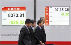  Businessmen walk past at an electric market board in Tokyo, Friday, Nov. 7, 2008. Japan's Nikkei 225 plunges 7 percent in early trade following heavy Wall Street losses. (AP Photo/Katsumi Kasahara)