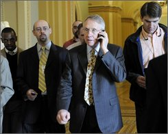 Senate Majority Leader Harry Reid of Nev. talks on the phone as he heads to his office on Capitol Hill in Washington, Thursday, Nov. 6, 2008, for a meeting with Sen. Joe Lieberman, I-Conn. (AP Photo/Susan Walsh)