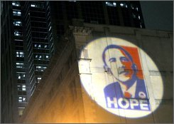 The poster for of the campaign for President-elect Barack Obama is projected on the back wall of the Masonic Lodge Temple Building in Raleigh, N.C., Tuesday, Nov. 4, 2008. (AP Photo/Karen Tam)