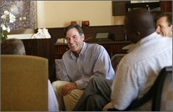 Oakland Athletics' general manager Billy Beane talks with other baseball executives at the lobby lounge of the St. Regis Hotel where Major League Baseball's general manager meetings are being held Wednesday Nov. 4, 2008 in Dana Point, Calif. (AP Photo/Lenny Ignelzi)