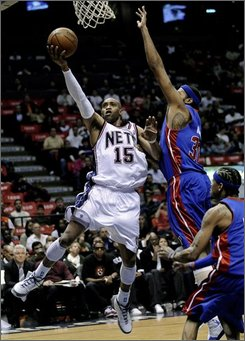 New Jersey Nets' Vince Carter, left, goes up with a shot as he gets by Detroit Pistons' Rasheed Wallace during the second quarter of an NBA basketball game Friday, Nov. 7, 2008 in East Rutherford, N.J. (AP Photo/Bill Kostroun)