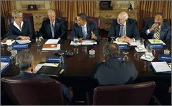President-elect Obama, center, meets with his economic advisory team in Chicago, Friday, Nov. 7, 2008. Facing camera, from left are, Michigan Gov. Jennifer Granholm, Vice President-elect Joe Biden, former Federal Reserve Chairman Paul Volcker and Time Warner Chairman Richard Parsons. Back to camera, from left are, White House Chief of Staff-designate Rahm Emanual and Google CEO Eric Schmidt.  (AP Photo/Pablo Martinez Monsivais)