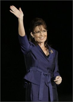 In this Nov. 4, 2008 file photo, Gov. Sarah Palin, R-Alaska, acknowledges the crowd during an election night rally in Phoenix.  Palin and Republican Party lawyers are still trying to sort out tens of thousands of dollars worth of donor-financed clothing and accessories purchased on the presidential campaign trail.    (AP Photo/Elise Amendola, File)
