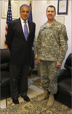 "In this photograph provided by Maj. Gen. David Blackledge, Blackledge, right, stands next to then U.S. Ambassador to Iraq Zalmay Khalilzad in Iraq in this undated photograph. Blackledge got psychiatric counseling to deal with wartime trauma, and now is defying the military's culture of silence on the subject of mental health problems and treatment. ""It's part of our profession ... nobody wants to admit that they've got a weakness in this area,"" Blackledge said of mental health problems among troops returning from America's two wars.   (AP Photo)"