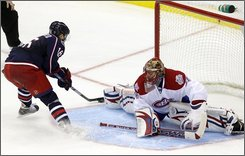 Columbus Blue Jackets' Derick Brassard, left, scores against Montreal Canadiens' Jaroslav Halak, of Slovakia during the shootout of an NHL hockey game Friday, Nov. 7, 2008, in Columbus, Ohio. The Blue Jackets defeated the Canadiens 4-3. (AP Photo/Jay LaPrete)