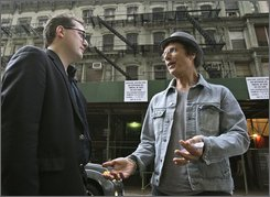 Simeon Banoff, left, an advocate for New York City's historic neighborhoods, and Tin Pan Alley tenant Leland Bobbe stand outside a group of Chelsea buildings that they hope won't be destroyed to be replaced by high rises in New York, Thursday, Oct. 16, 2008. The group of five buildings, including one where Bobbe lives, once housed Irving Berlin, George and Ira Gershwin, and dozens of other great American songwriters. (AP Photo/Kathy Willens)