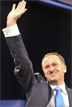 Prime Minister elect John Key celebrates the National Party's victory during the New Zealand General election in Auckland, New Zealand, Saturday, Nov. 8, 2008. (AP Photo/NZPA, Ross Setford)