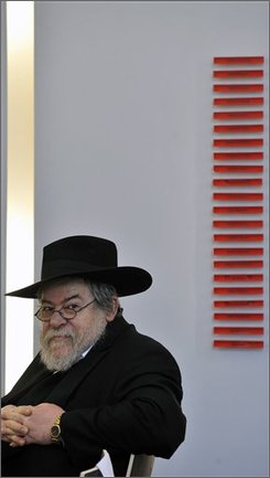 Chief Rabbi of the Czech Republic Karol Sidon, seen, in front of the names of victims on the new Holocaust Memorial in Liberec, some 100 kilometers north of Prague, Czech Republic, on Sunday, Nov. 9, 2008. The memorial opened to mark the 70th anniversary of Kristallnacht (Crystal Night) or the Night of Broken Glass, a pogrom in Nazi Germany, on Nov. 9-10, 1938. (AP Photo/CTK, Radek Petrasek)