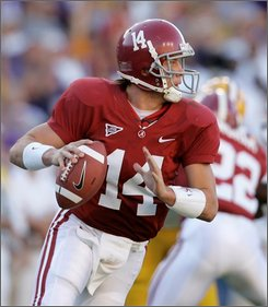 Alabama quarterback John Parker Wilson (14) scrambles out of the pocket as he looks for an open receiver in the first half of an NCAA college football game against LSU in Baton Rouge, La., Saturday, Nov. 8, 2008.  (AP Photo/Tony Gutierrez)