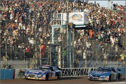 Carl Edwards, left, beats out Denny Hamlin for the checkered flag at the finish of the NASCAR Nationwide Series Hefty Odor Block 200 at Phoenix International Raceway  Saturday, Nov. 8, 2008 in Avondale, Ariz. (AP Photo/Jason Babyak)