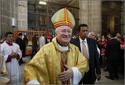 Italy's Cardenal Ennio Antonelli arrives for mass services at the Metropolitan Cathedral in Mexico City, Sunday, Nov. 9, 2008. Antonelli spoke about Pope Benedict XVI's decision not to attend an event in Mexico City scheduled for next year. (AP Photo/Gregory Bull)
