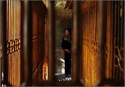 A Chinese traditional music performer waits before her performance inside Juanqinzhai, a newly restored 18th-century royal studio which includes a private theater, in the Forbidden City in Beijing, China, Monday, Nov. 10, 2008. (AP Photo/Alexander F. Yuan)