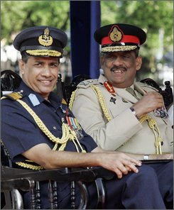 Sri Lankan Army Commander Lt. Gen. Sarath Fonseka, right, and Air Vice Marshal Roshan Goonatilake look on during the commemorative wreath laying ceremony in recognition of the contribution made in the World Wars and the fights against Tamil Tiger separatists, in Colombo, Sri Lanka, Sunday, Nov. 9, 2008. (AP Photo/ Gemunu Amarasinghe)