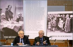 Holocaust survivors Ernest Michel, 85, left, and Roman Kent, 83, speak during a news conference in New York, Monday, Nov. 10, 2008, in which they said they are through trying to negotiate with the Mormon church over posthumous baptisms of Jews killed in Nazi concentration camps. Michel is seated beside pictures of his parents, left and right, who were killed in Auschwitz. Kent is chairman of the American Gathering of Jewish Holocaust Survivors and Michel is honorary chairman. (AP Photo/Kathy Willens)