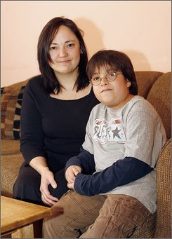 Janice Kraser sits next to her nine-year-old son Billy Kraser at their Scranton, Pa., home Sunday, Nov. 9, 2008. Billy Kraser has spina bifida and has undergone an experimental surgery which reroutes his nerves in attempt to attain normal bladder and bowel function. (AP Photo/Jimmy May)