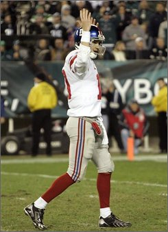 New York Giants quarterback Eli Manning signals a touchdown after running back Brandon Jacobs went up the middle for 3 yards in the third quarter of an NFL football game against the Philadelphia Eagles, Sunday, Nov. 9, 2008, in Philadelphia. (AP Photo/Tom Mihalek)