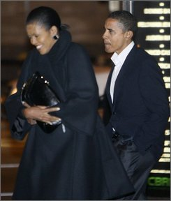 President-elect Obama, right, and Michelle Obama walk out of Spiaggia restaurant after having dinner in Chicago, Saturday, Nov. 8, 2008. (AP Photo/Charles Dharapak)