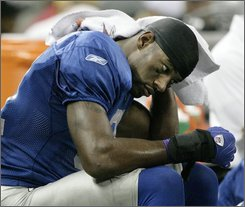 Detroit Lions wide receiver Calvin Johnson sits on the bench in the fourth quarter of their 34-14 loss to the Jacksonville Jaguars in an NFL football game Sunday, Nov. 9, 2008, in Detroit. (AP Photo/Duane Burleson)