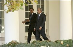 President Bush walks with President-elect Obama along the West Wing Colonnade at the White House in Washington, Monday, Nov. 10, 2008, to the Oval Office for a private meeting. (AP Photo/Evan Vucci)