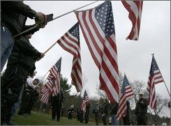 Members of veterans motocycle groups hold flags during a ceremony for four forgotten veterans at the Vermont Veterans Memorial Cemetery in Randolph , Vt., Friday, Nov. 7, 2008. The veterans remains were located by the Missing in America Project , a national nonprofit organization dedicated to finding veterans remains in funeral and nursing homes across the nation.  (AP Photo/Toby Talbot)