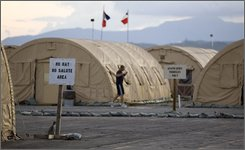 In this June 4, 2008 file photo, a U.S. trooper jogs at the tent city next to Camp Justice, the legal complex of the U.S. Military Commissions, at Guantanamo Bay U.S. Naval Base, in Cuba.  (AP Photo/Brennan Linsley, File)