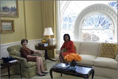 First lady Laura Bush and Michelle Obama sit in the private residence of the White House Monday, Nov. 10, 2008, after the President-elect and Mrs. Obama arrived for a visit and tour. (AP Photo/The White House, Joyce N. Boghosian)
