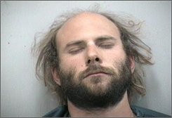In this image released by the Martin County Jail, John Samuel Ricci , of Canton, Conn., is shown in a booking mug, on Saturday, Nov. 8, 2008. Ricci was charged with two counts of simple battery, theft and disruption of a religious assembly, after police say he tried to steal communion wafers during a church service in Jensen Beach, Fla. (AP Photo/Martin County Jail)