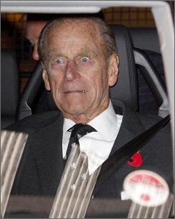 Britain's Prince Philip reacts to a blast from the ship's fog horn, as he is driven away following a visit to the liner Queen Elizabeth 2, in Southampton, England, Tuesday Nov. 11, 2008.  The ship is in Southampton for the last time before departing on its final voyage to Dubai, where it will become a floating hotel.(AP Photo/Chris Ison-pa)