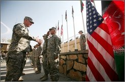 U.S. Maj. Gen. Robert W. Cone, left, Combined Security Transition Command, greets a soldier after he became a U.S. citizen during a ceremony at Camp Eggers in Kabul, Afghanistan, Tuesday, Nov. 11, 2008. (AP Photo/Rafiq Maqbool)