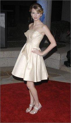 Singer Taylor Swift arrives at the 2008 BMI Country Awards, in Nashville, Tenn., Tuesday, Nov. 11, 2008.  (AP Photo/Peter Kramer)