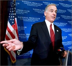  Democratic National Committee Chairman Howard Dean gestures at the conclusion of a forum about Tuesday's presidential election, Wednesday,Nov. 5, 2008, at the National Press Club in Washington.    (AP Photo/Manuel Balce Ceneta)