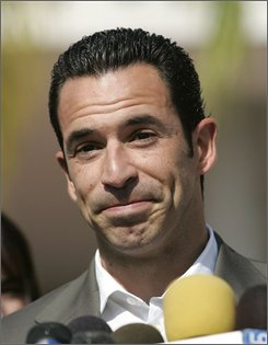 "In this Oct. 3, 2008, file photo, Helio Castroneves, the two-time Indianapolis 500 winner and U.S. television's ""Dancing With The Stars"" champion, talks to reporters outside federal court after posting a $10 million bond in Miami.  (AP Photo/David Adame, file)"