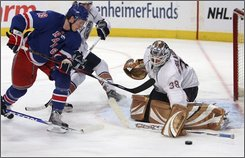 Edmonton Oilers goalie Jeff Drouin-Deslauriers (38) defends the net against New York Rangers forward Lauri Korpikoski, of Finland, during the second period of an NHL hockey game Monday, Nov. 10, 2008, at Madison Square Garden in New York. (AP Photo/Mary Altaffer)