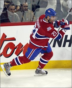 Montreal Canadiens' Christopher Higgins celebrates after scoring his first goal against the Ottawa Senators during first period NHL  hockey action in Montreal, Tuesday, Nov. 11, 2008. (AP Photo/The Canadian Press, Ryan Remiorz)